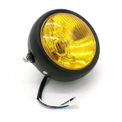 svart framlykta med gult glas för motorcykel