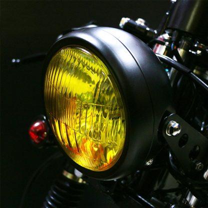 Gul framlykta monterad på motorcykel