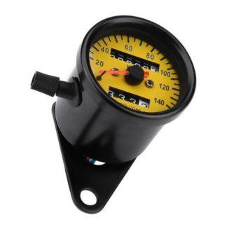 Hastighetsmätare vintage med gul visarbotten och oljetryckslampa